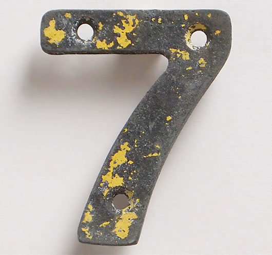 Vintage cast-metal railway marker number '7'