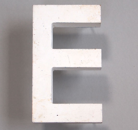 Vintage white painted wooden sign letter 'E'