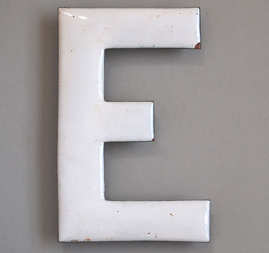 Early-1900s vintage white enamel and brass sign letter 'E'
