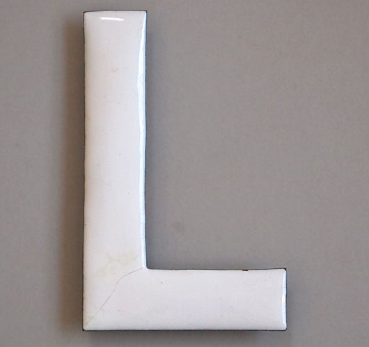Early-1900s vintage white enamel and brass sign letter 'L'