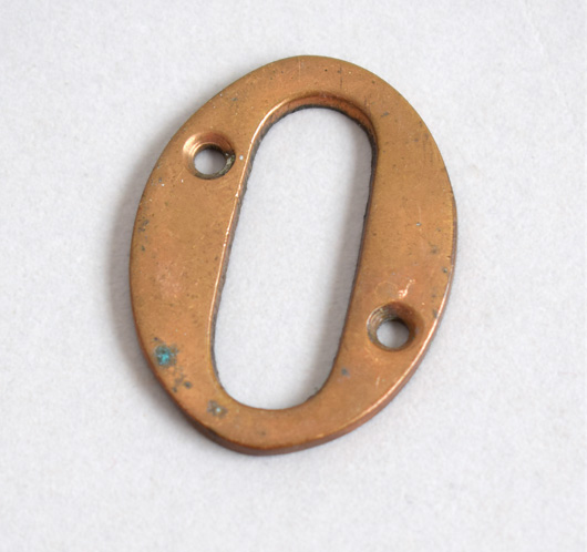 Antique brass house door number: '0'