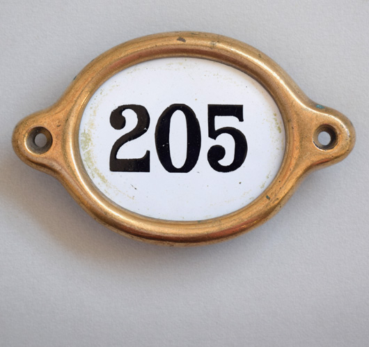 Early-1900s vintage brass and enamel hotel door number: '205'