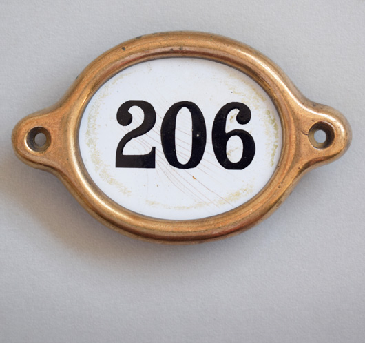 Early-1900s vintage brass and enamel hotel door number: '206'