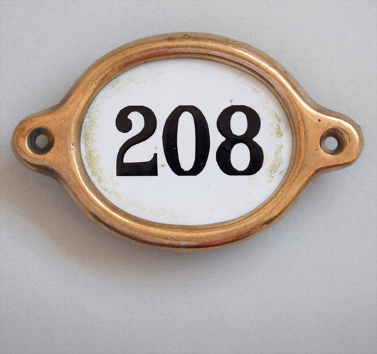 Early-1900s vintage brass and enamel hotel door number: '208'