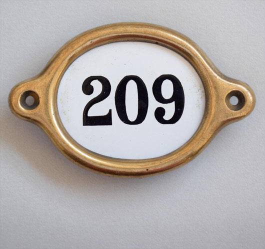 Early-1900s vintage brass and enamel hotel door number: '209'