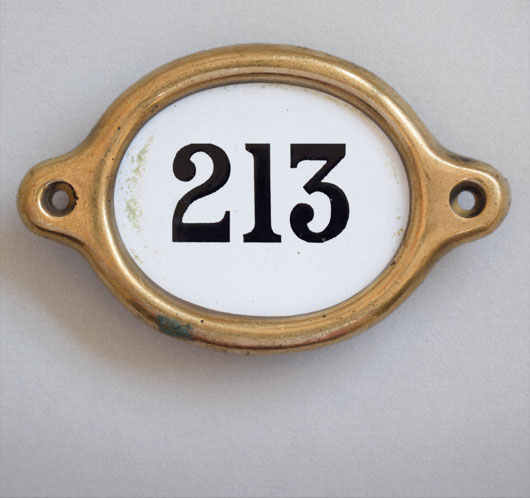 Early-1900s vintage brass and enamel hotel door number: '213'