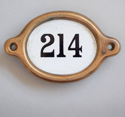 Early-1900s vintage brass and enamel hotel door number: '214'