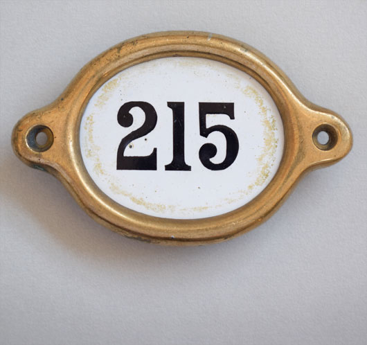 Early-1900s vintage brass and enamel hotel door number: '215'