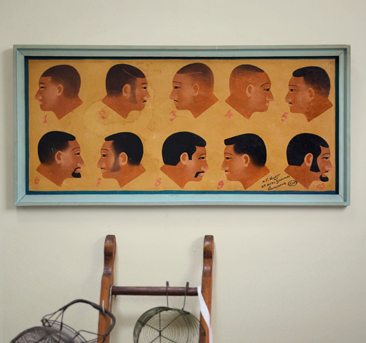 1970s African barber shop hairstyle sign