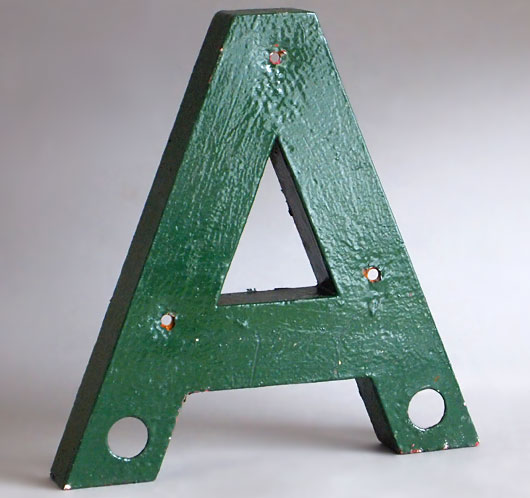 Large vintage green painted metal shop sign letter 'A', 31cm