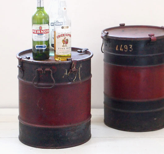 Vintage black and red motor oil drum side table, c. 1920s