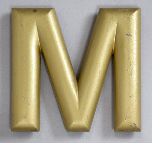 Early-1900s vintage gold pub sign letter 'M' or 'W'
