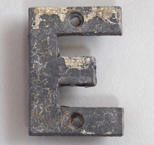 Small cast-metal antique sign letter 'E', c.1900