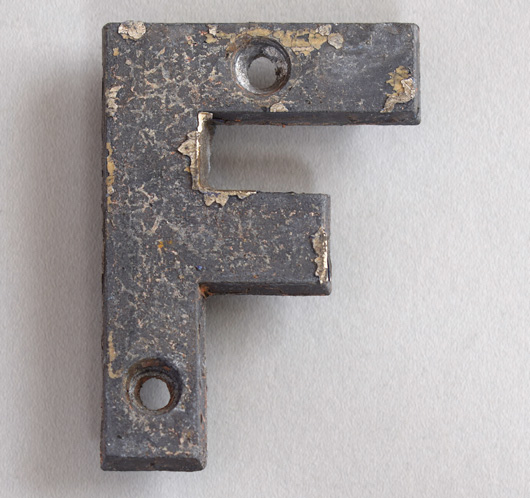 Small antique cast-metal sign letter 'F', c. 1900