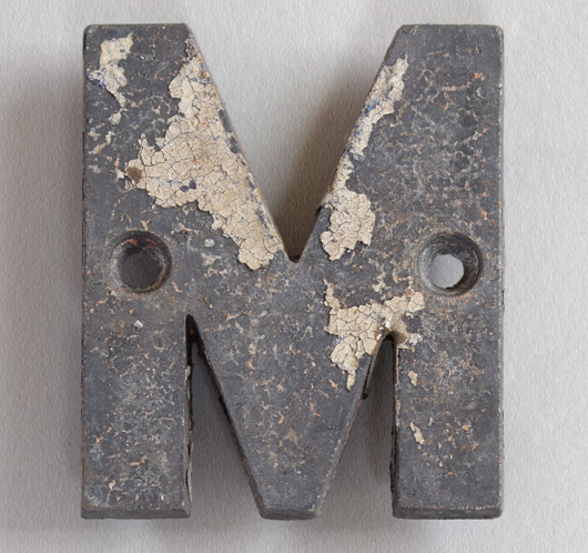 Small cast-metal antique sign letter 'M' or 'W', c.1900
