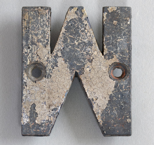 Small antique cast-metal sign letter 'M' or 'W', c. 1900