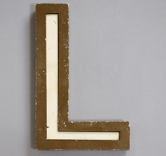 Large vintage gold resin letter 'L' with white glass inlay