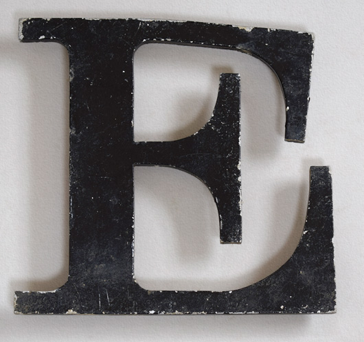 Painted vintage cast-metal shop sign letter 'E'