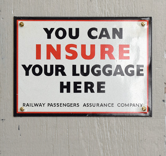 Vintage tin railway luggage insurance sign
