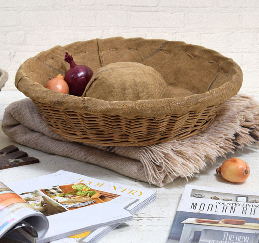 Vintage round French linen-lined bread proving basket