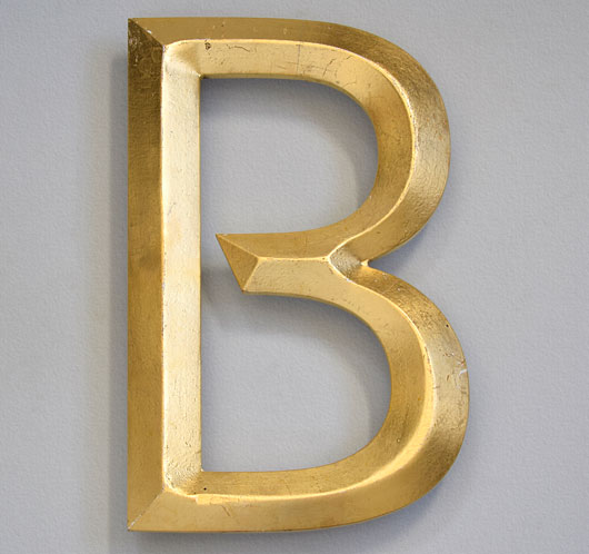 Vintage gold-leaf pub sign letter 'B'