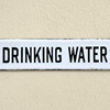 Early-1900s enamel sign: Drinking Water