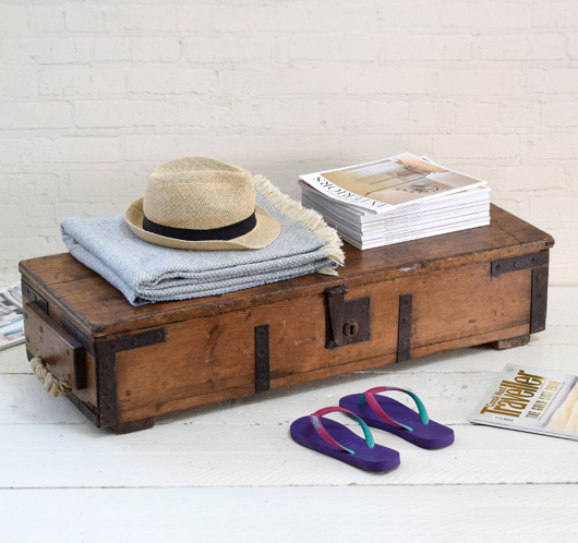 Antique elongated wooden blanket box, 1916