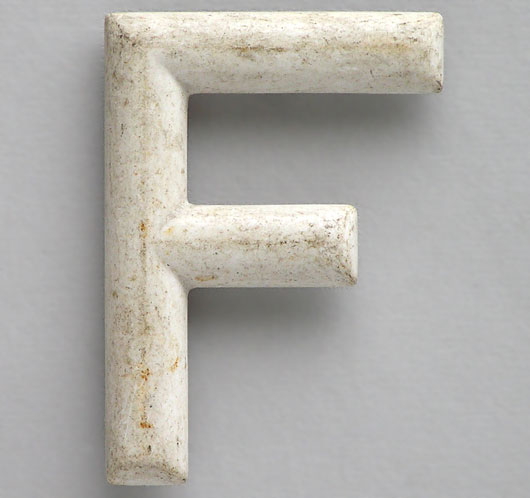 Early automobile number plate plastic letter 'F'