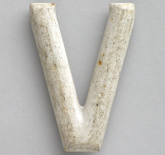 Early car number plate plastic letter 'V'
