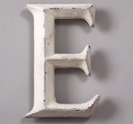 Early-1900s vintage white painted metal shop sign letter 'E'