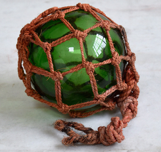 Antique glass fishing buoy with hemp net, c. 1900