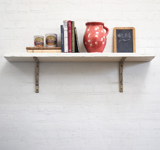 Large wooden shelf with antique iron brackets