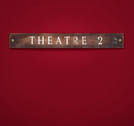 Antique enamel and brass door sign: Theatre 2