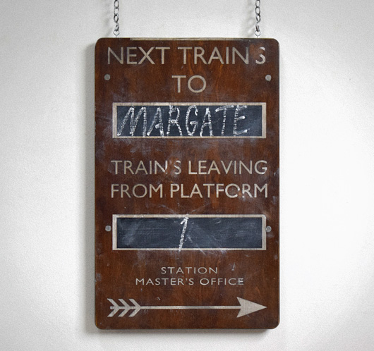 Painted vintage wooden railway sign: Next Trains To...