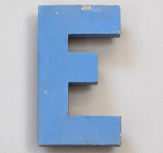 Mid-1900s blue metal shop sign letter 'E'