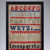 Framed Victorian child's needlepoint tapestry sampler