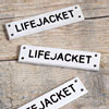 Black and white acrylic sign: Life Jacket