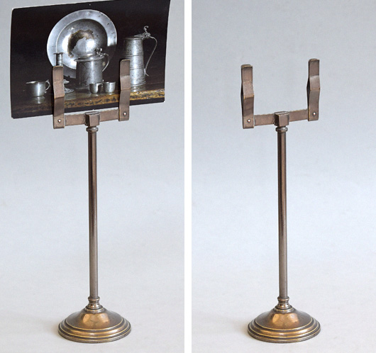 Early-1900s antique metal shop display stand