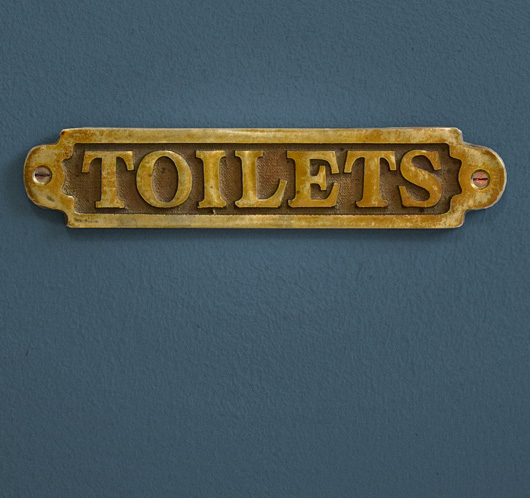 Early-1900s vintage brass pub sign: Toilets
