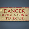 Early-1900s cast-metal staircase sign