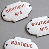 Antique enamel shopping arcade signs
