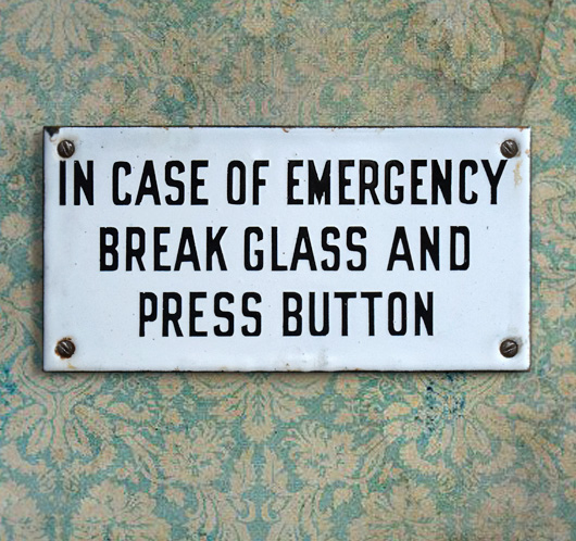 Antique enamel sign: In Case Of Emergency...