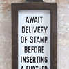 Early postage stamp vending machine sign