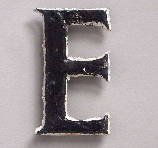 Small vintage painted brass letter 'E', early 1900s