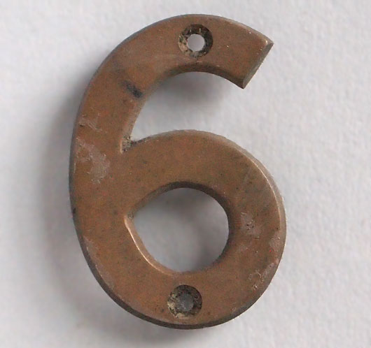 Small vintage cast-bronze sign number '6' or '9', early 1900s