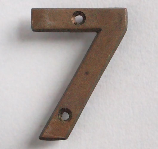 Small early-1900s cast-bronze sign number '7'