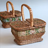 Pair of early-1900s child's cane picnic baskets