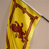Scottish Royal Arms flag on wooden pole