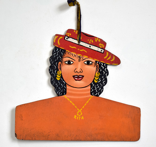 Vintage West African folk art dress hanger: Rita